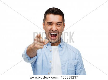 anger, emotions, aggression, gesture and people concept - angry man shouting and pointing finger on you