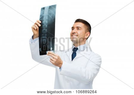 healthcare, rontgen, people and medicine concept - smiling male doctor in white coat looking at x-ray