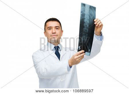 healthcare, rontgen, people and medicine concept - male doctor in white coat holding x-ray