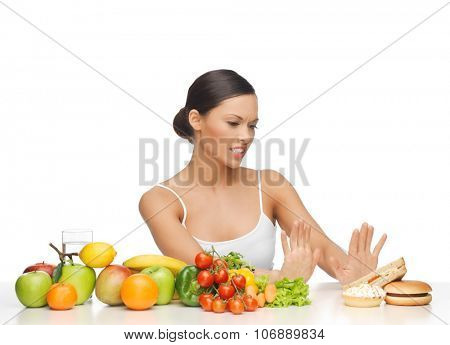 picture of woman with fruits rejecting hamburger