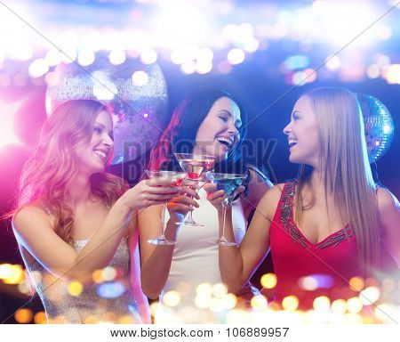 holidays, nightlife, bachelorette party and people concept - smiling women with cocktails at night club