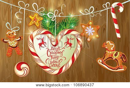 Holiday Greeting Card With Xmas Gingerbread, Candy And Fir-tree Branches. Hand Written Calligraphic