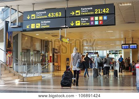 VALENCIA, SPAIN - OCTOBER 12, 2015: Airline Passengers inside the Valencia Airport. About 4.98 million passengers passed through the Valencia, Spain airport in 2014.
