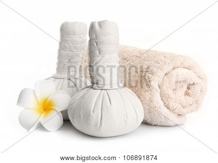 Spa set with massage balls, towel and frangipani flower isolated on white