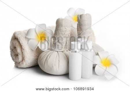 Spa set with massage balls, towel, aroma oil and frangipani flower isolated on white