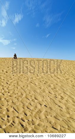 Woman Resting In The Dunes
