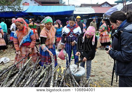 Hmong Women Selling Sugar Cane In Bac Ha Market, Vietnam