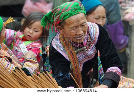 Vietnamese Woman Selling Incense Sticks In Bac Ha Market, Vietnam