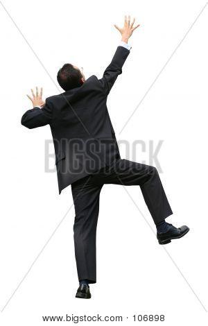 Business Man Climbing A Wall