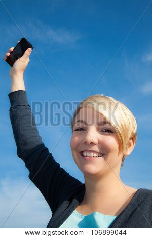 Attractive young woman using smart phone