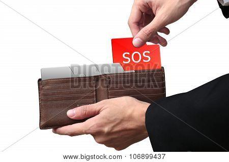 Businessman Hands Pulling Folder Sos Concept On Brown Wallet.