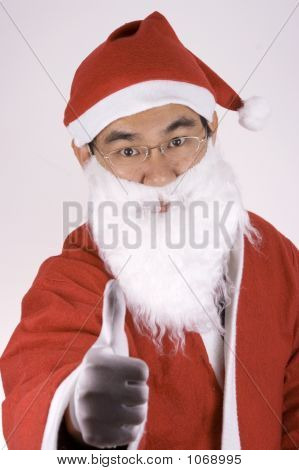 Asian Santa Claus With Thumbs Up
