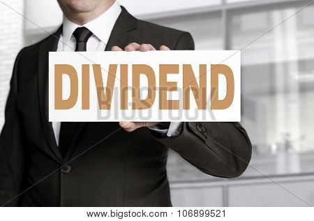 Dividend Sign Is Held By Businessman Concept