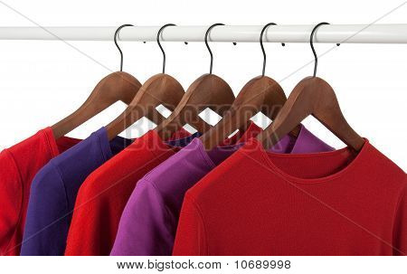 Red And Purple Casual Shirts On Hangers