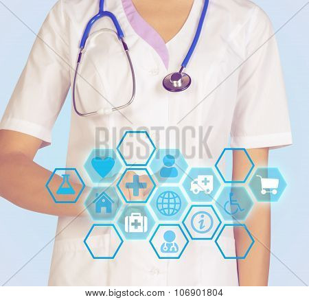 Doctor presses on index finger computer icon interface