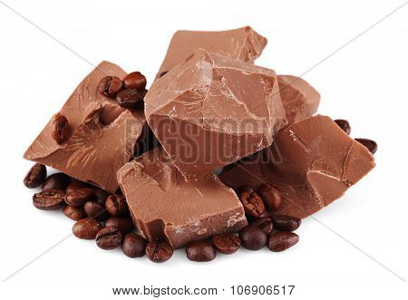 Milk chocolate pieces with coffee grains isolated on white