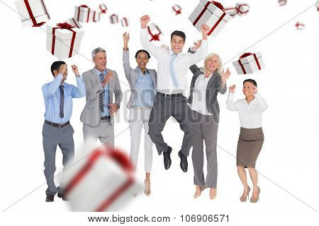 Business people cheering in office against white and red gift box