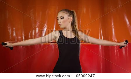 Fit Girl Doing Exercises With Expander In Gym