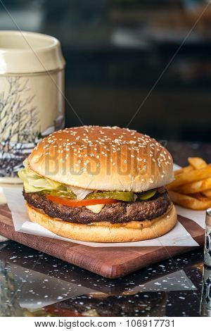 Cheeseburger Served  With French Fries And Beer