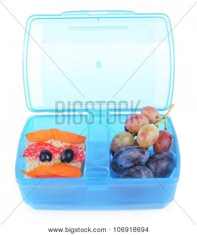 Creative sandwich and fruits in plastic lunchbox isolated on white background