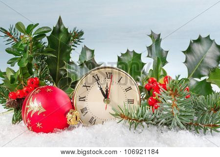 Christmas clock with Holly leaves and berries