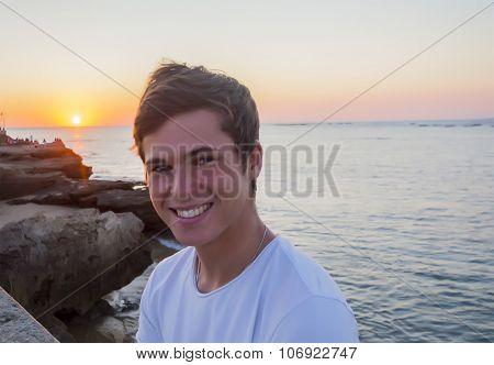 Handsome Male Model Smiling After Sunset