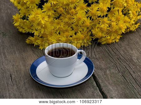 Bouquet Of Beautiful Yellow Flowers And Cup Of Black Coffee