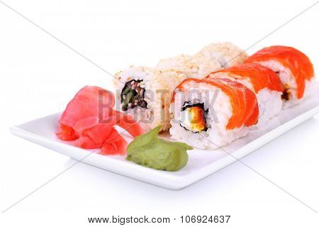Tasty rolls, ginger and wasabi isolated on white