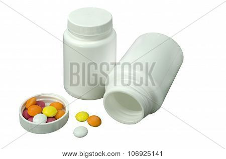 Some Pills Of A Different Colors With Two White Jar