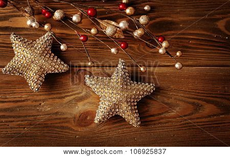 red and gold christmas ornaments on wooden background