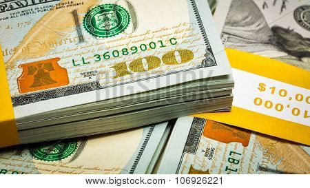 Creative business finance making money concept - panoramic image of new 100 US dollars 2013 edition banknotes (bills) bundles close up