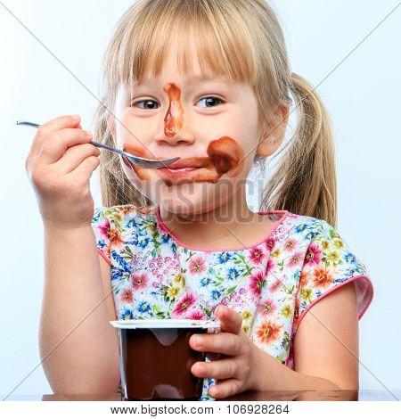 Cute Girl Eating Chocolate Yogurt.