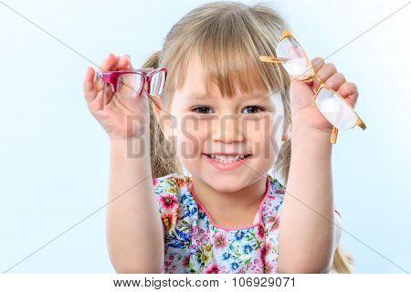 Cute Girl Holding Glasses.