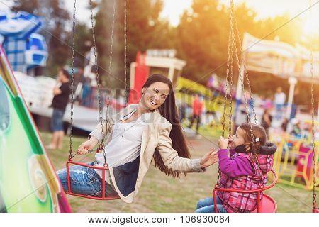 Mother and daughter at fun fair