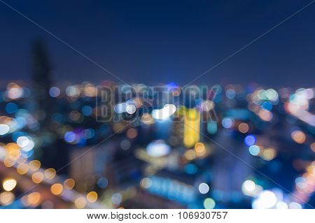 Aerial view of city downtown lights at night, abstract blurred bokeh background