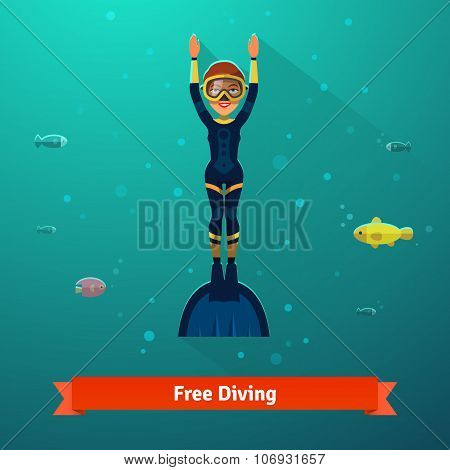 Surfacing free diver woman in wetsuit