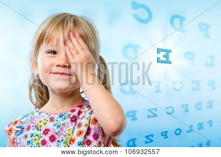 Little Girl Reading Eye Chart.