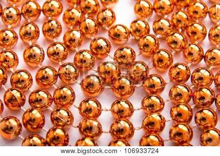 Close up of little golden balls.