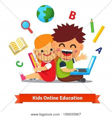 Boy and girl studying together with laptop