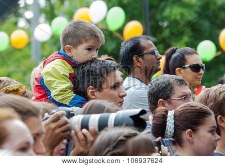 Father And Son Watching A Concert