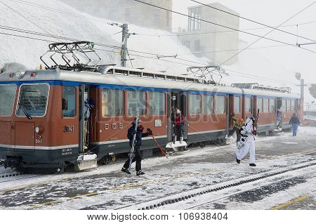People disembark from the train at the upper Gornergratbahn railway station in Zermatt, Switzerland.