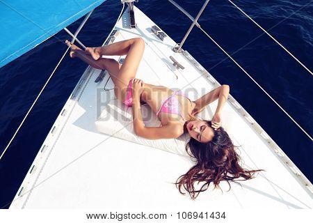 Beautiful Woman Wears Pink Bikini, Relaxing On Yacht In The Sea