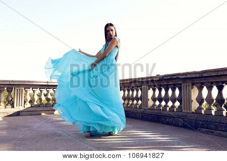 Gorgeous Woman Wears Luxurious Elegant Dress, Posing Near Antic Palace