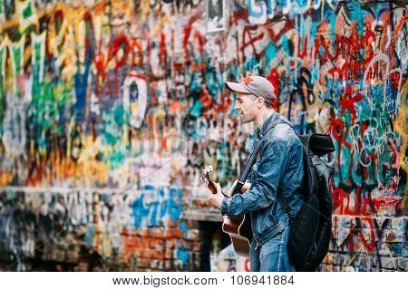 Man sings music band KINO songs near Viktor Tsoi Wall in Moscow, Russia