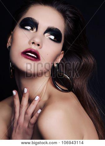 Beautiful Woman With Dark Hair And Extravagant Black Smokey Eyes Makeup