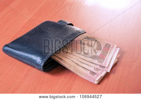 Hundred Ukrainian Hryvnia Banknotes In Black Purse