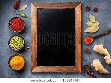 Various Spices Near Blackboard