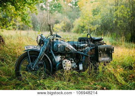 Old BMW R75 motorbike, motorcycle in summer forest