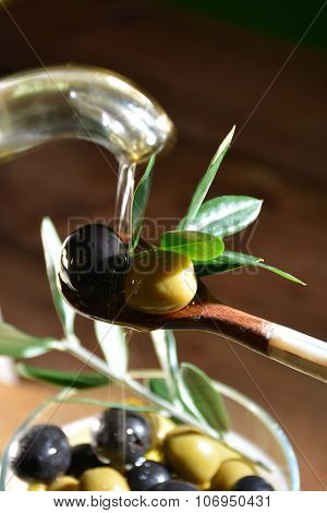 Olive Oil Falling On Two Olive With Olive Leaves