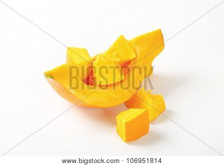 sliced yellow pumpkin on white background
